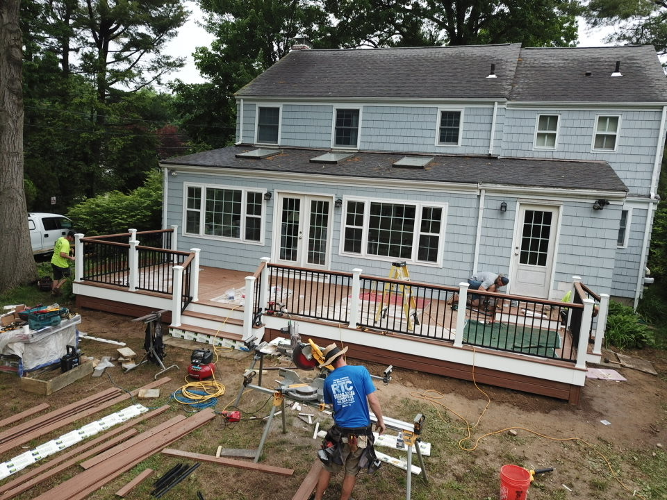 Building A New Deck Image of Workers from Regan Total Construction