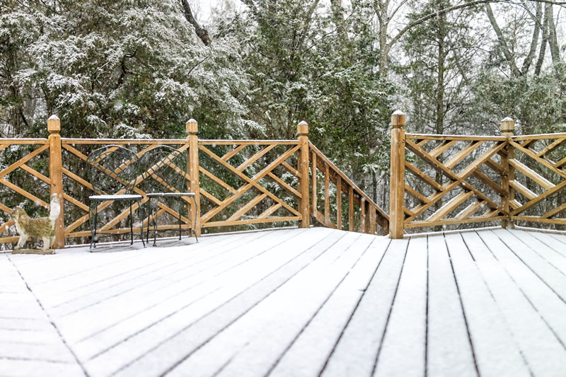 picture of a deck in winter a snowy scene. Regan total construction can build decks in the winter